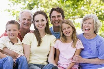 Large family sitting outside smiling near 19014 dentist office