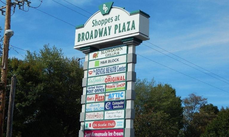 Sign for The Dental Health Center at Broadway Plaza in Aston PA